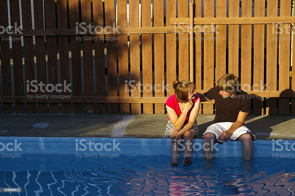 Couple by the Pool royalty-free stock photo