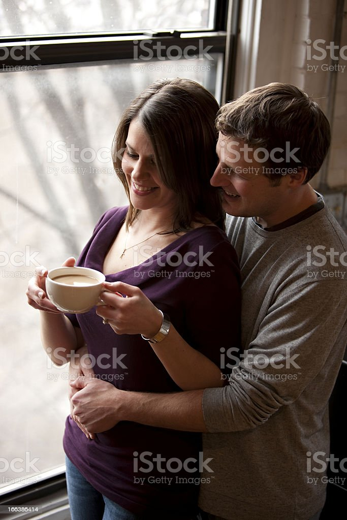 Couple by the Window Drinking Coffee royalty-free stock photo