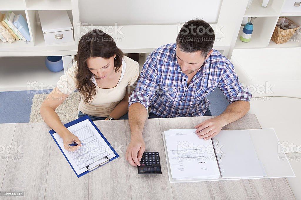 Couple Calculating Bills stock photo