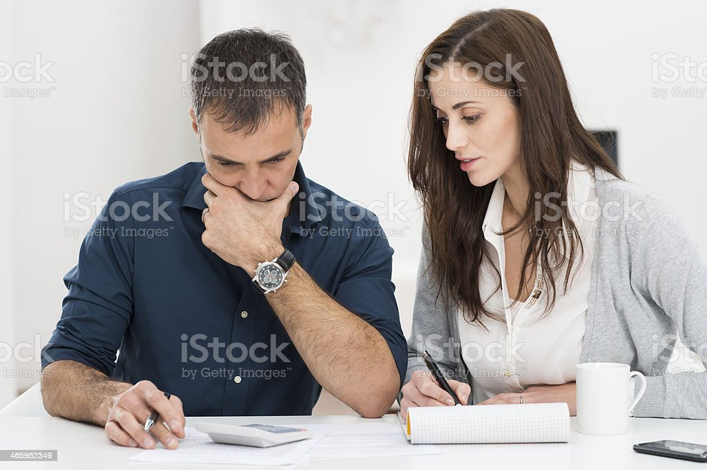 Couple Calculating Budget stock photo