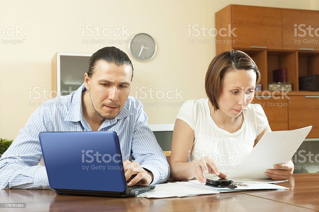 couple calculating family budget at home royalty-free stock photo