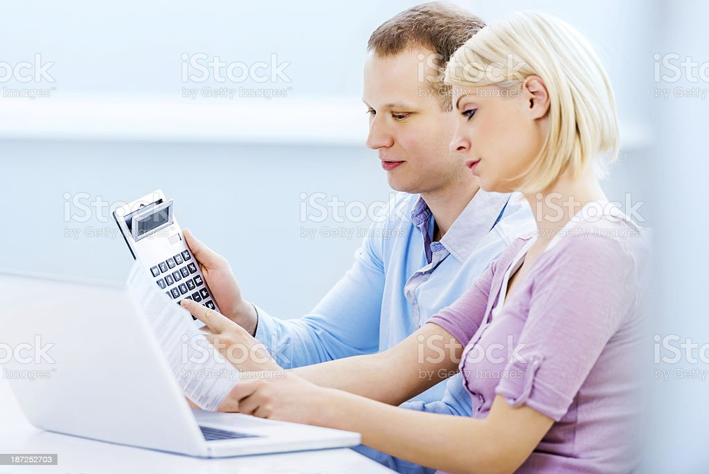 Couple calculating their monthly finances at home. royalty-free stock photo