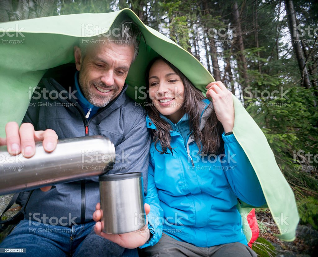 Couple camping and drinking coffee stock photo