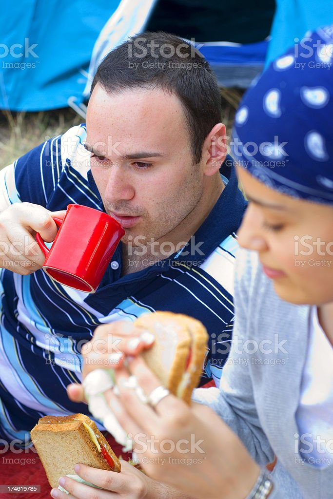 couple camping and having breakfast in wilderness royalty-free stock photo