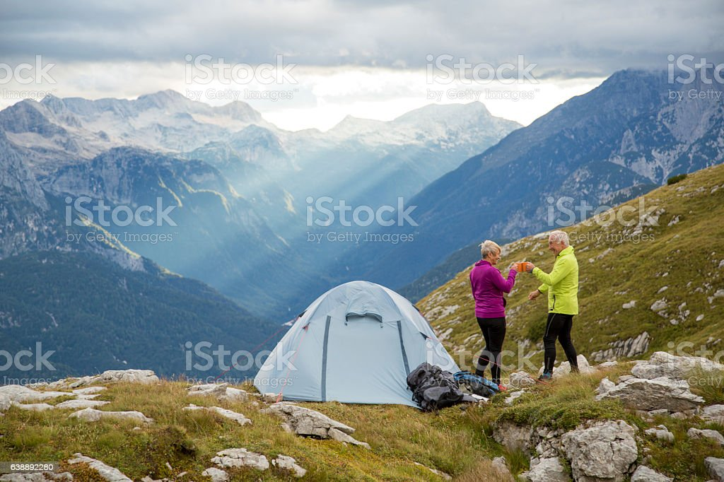 Couple camping on mountain stock photo