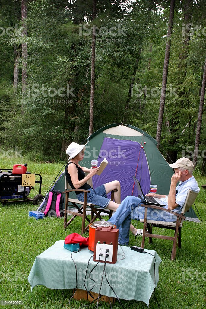 Couple camping, relaxing  fuel cell power --gasoline generator for sale royalty-free stock photo