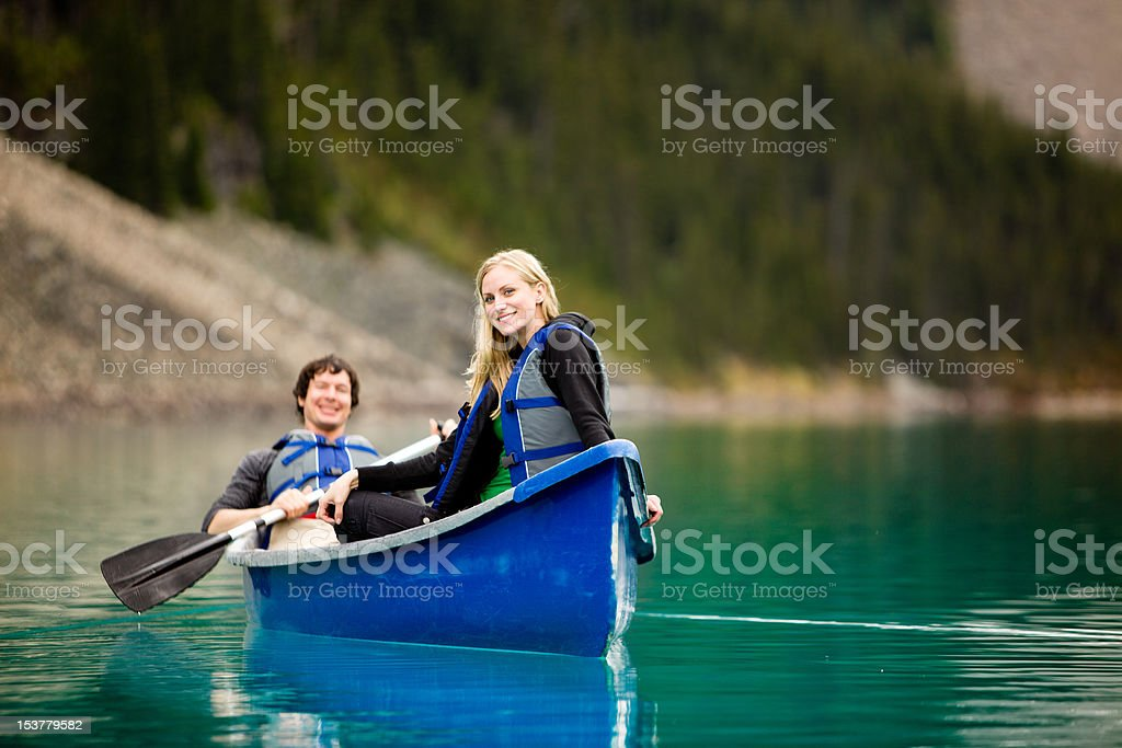 Couple Canoeing and Relaxing stock photo
