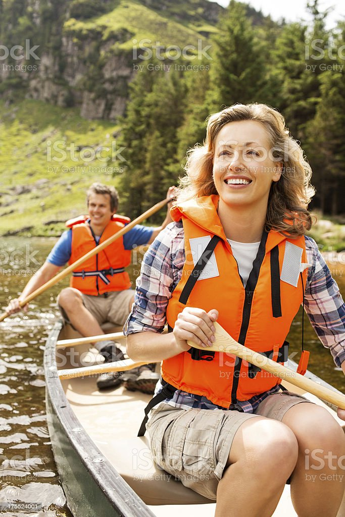 Couple Canoeing In Lake royalty-free stock photo