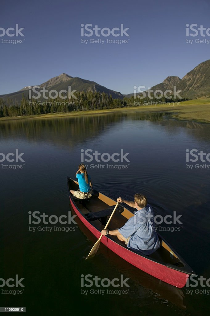 Couple Canoeing on Mountain Lake royalty-free stock photo