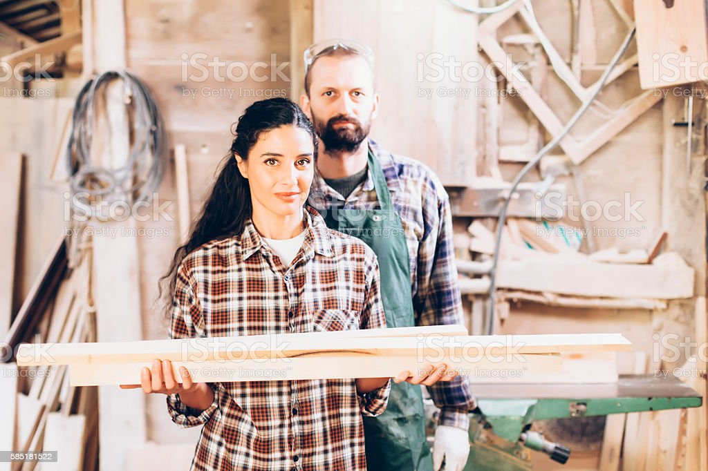 Couple carpenter workers at their workplace stock photo