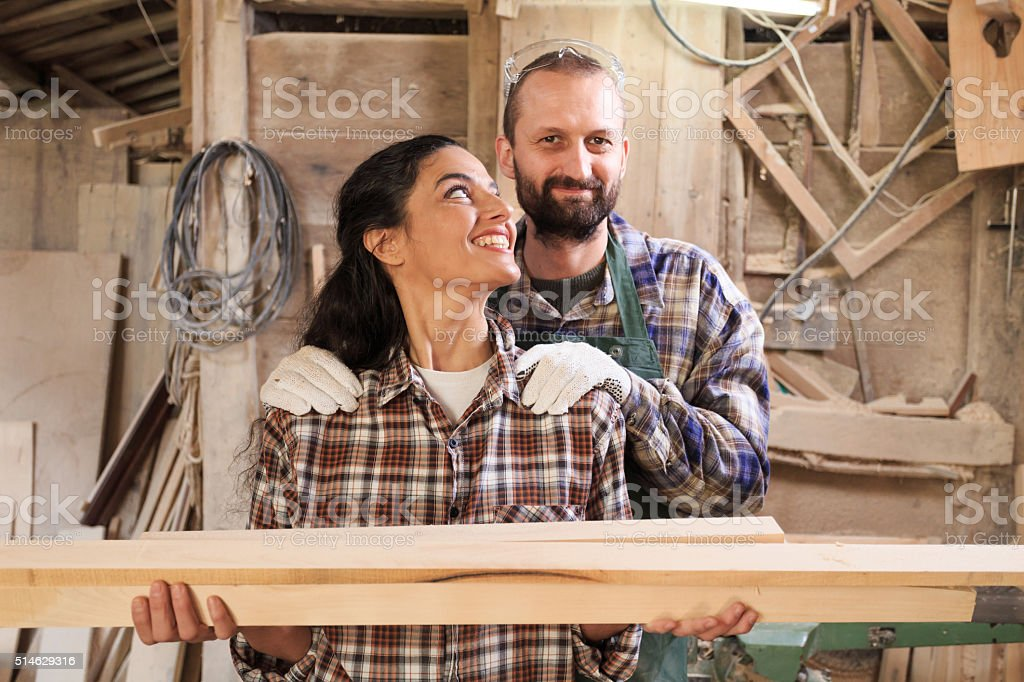 Couple carpenter workers working in their workshop stock photo