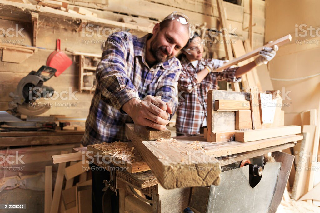 Couple carpenter workers working together stock photo