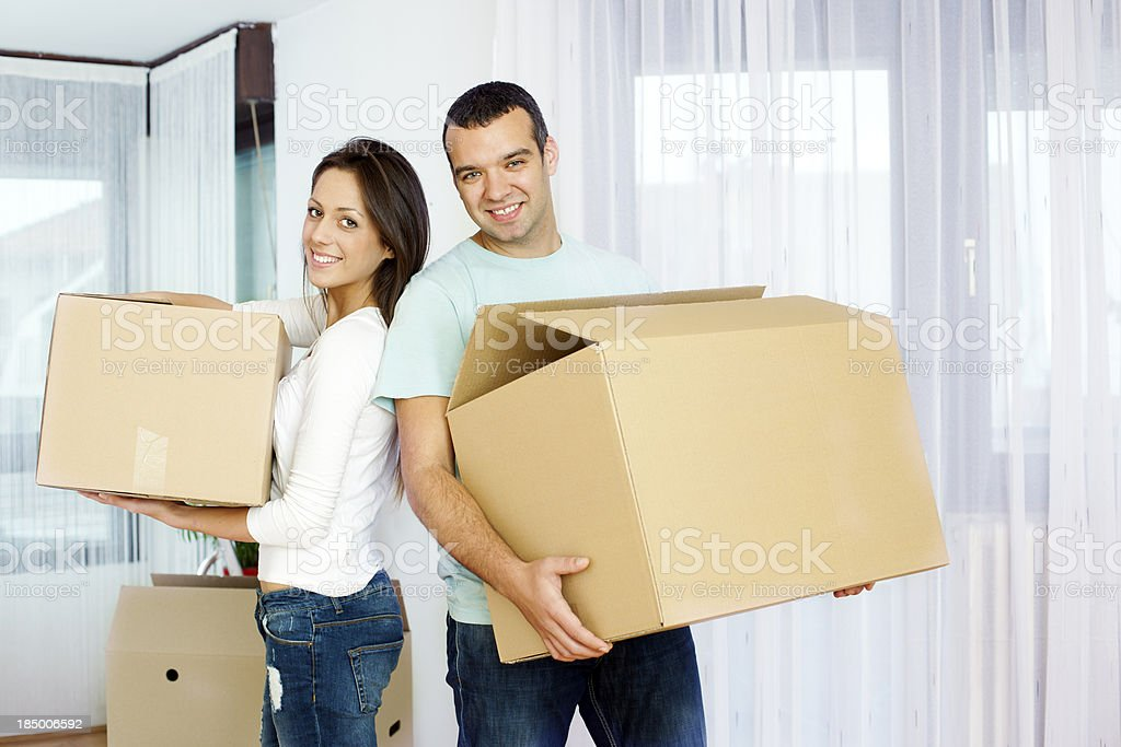 Couple Carry Boxes Moving House royalty-free stock photo