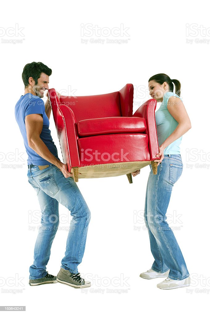 Couple carrying a chair royalty-free stock photo