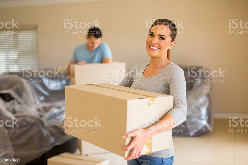 couple carrying boxes stock photo