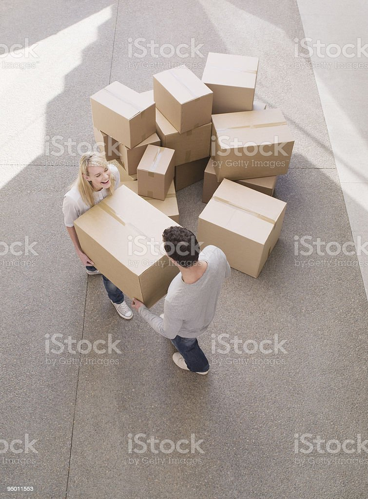 Couple carrying cardboard box royalty-free stock photo