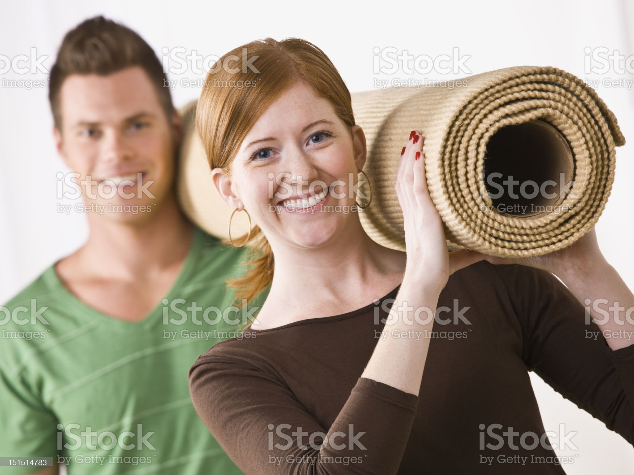 Couple Carrying Carpet Roll royalty-free stock photo
