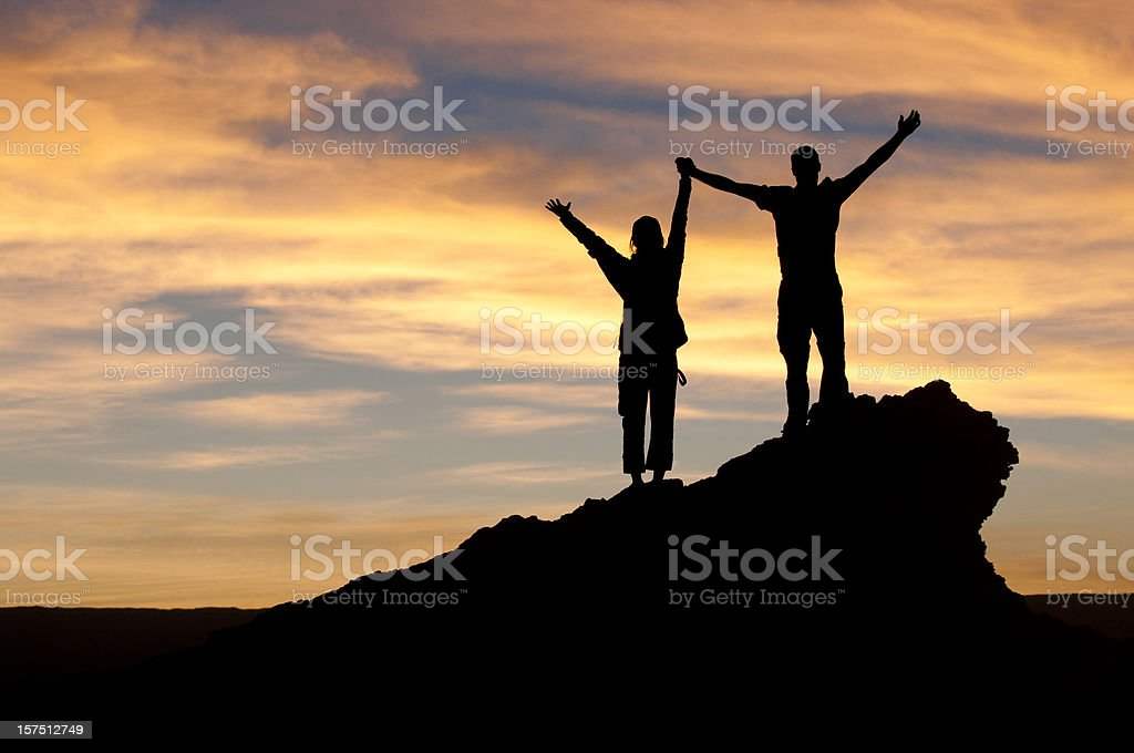 Couple celebrating a relationship victory stock photo