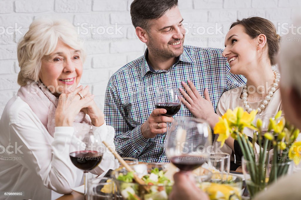 Couple celebrating anniversary with parents stock photo