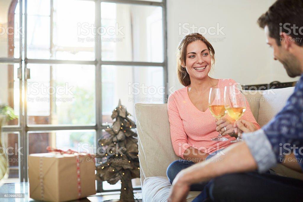 Couple celebrating christmas at home. stock photo