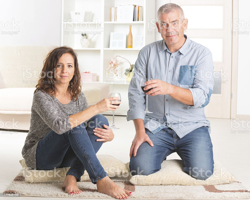 Couple celebrating in home royalty-free stock photo