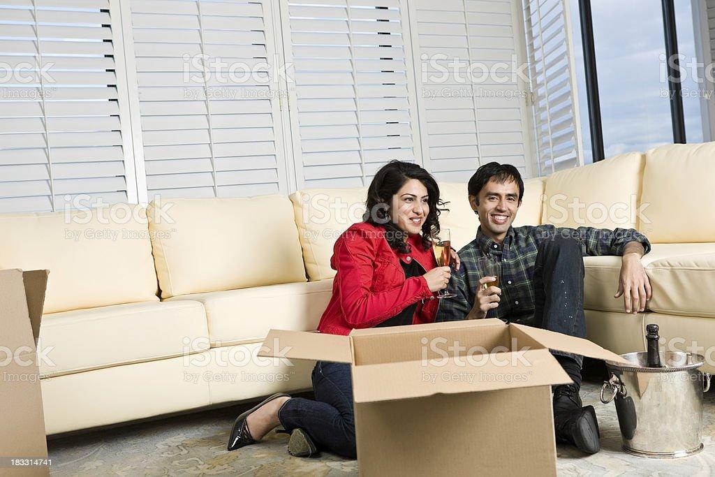 Couple Celebrating Moving Into Condominium royalty-free stock photo
