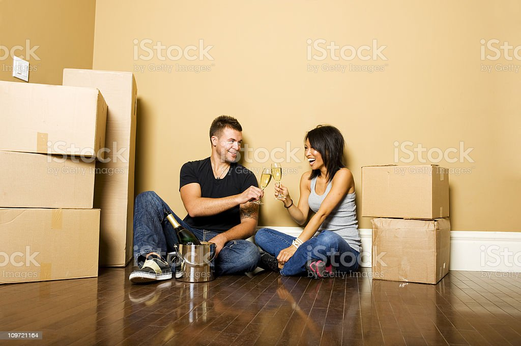 Couple celebrating moving royalty-free stock photo