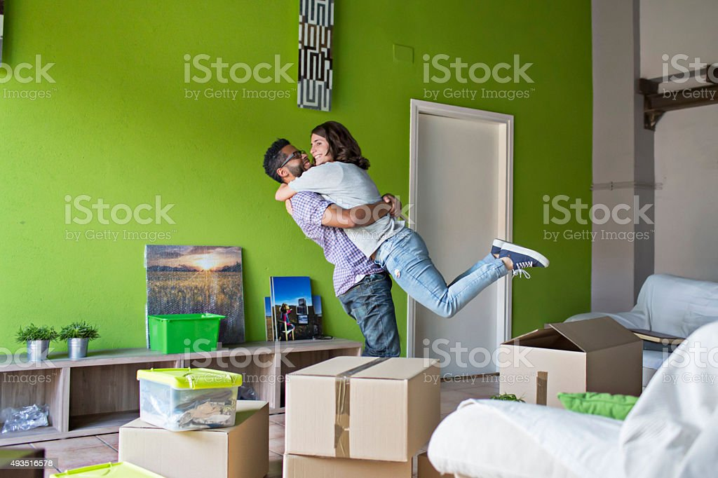 Couple celebrating moving to their new home stock photo