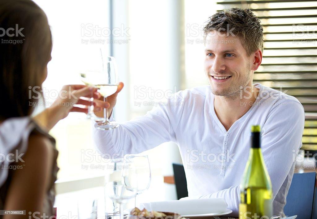 Couple Celebrating Something at a Restaurant stock photo