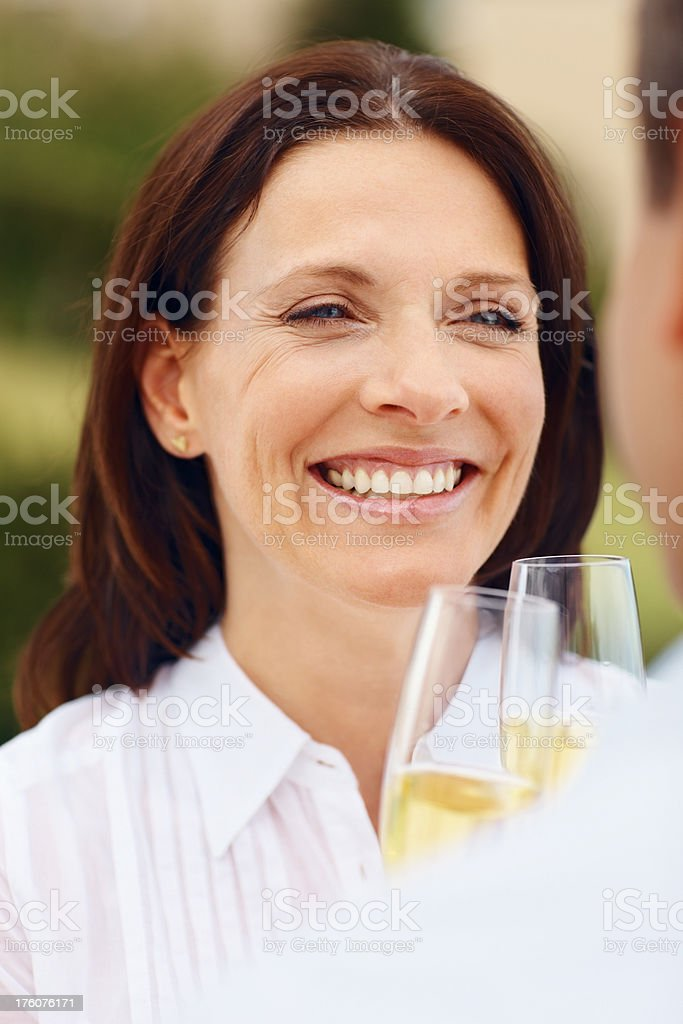 Couple celebrating with a glass of champagne royalty-free stock photo