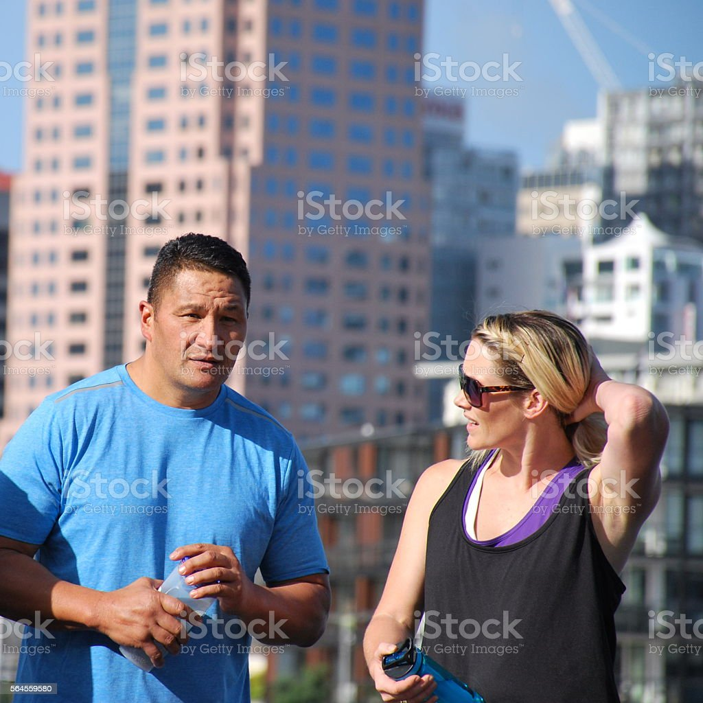 Couple Chatting against an Urban Scene stock photo