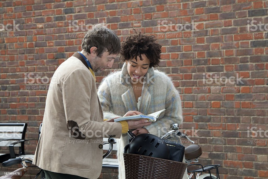 Couple Checking Map and Searching Directions in London royalty-free stock photo