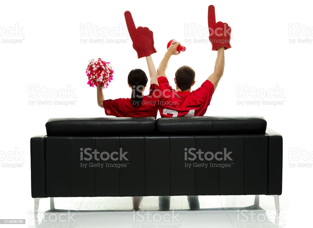 Couple cheering for sports team stock photo