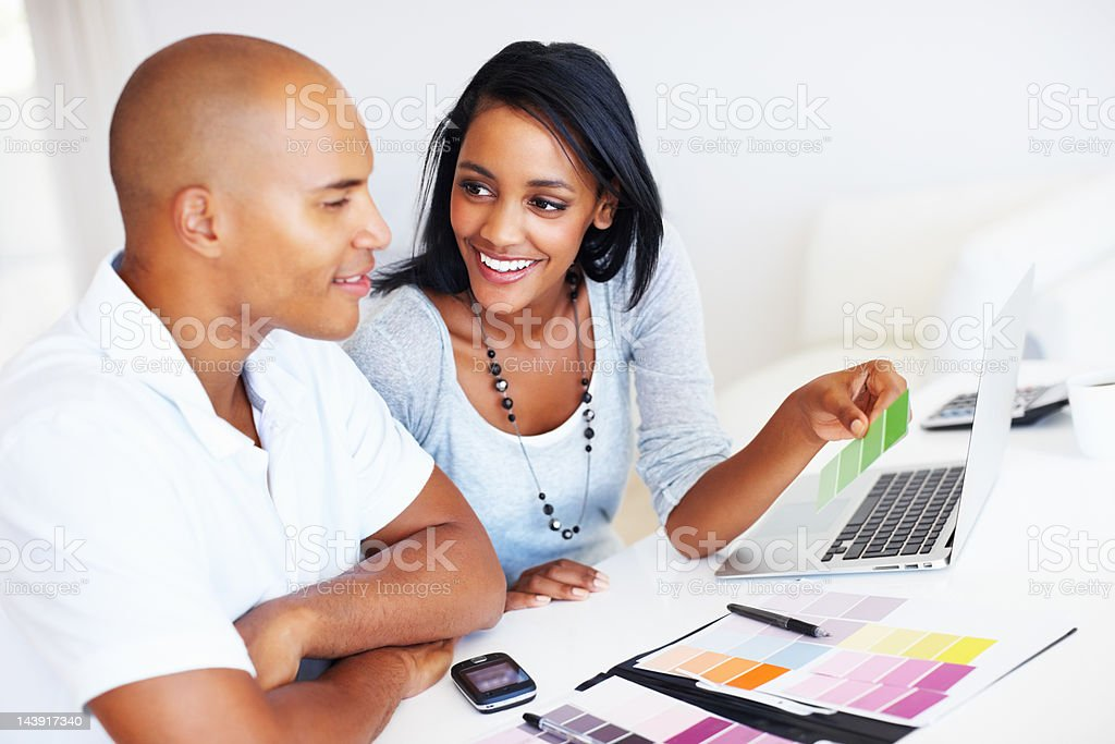 Couple choosing color samples for house stock photo