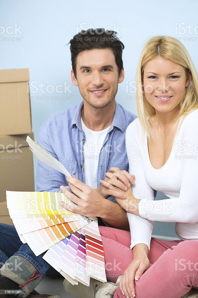 Couple choosing color swatches stock photo