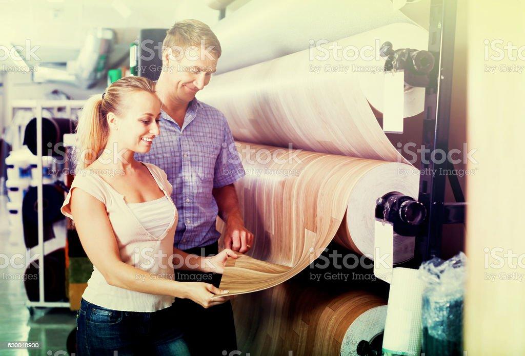 Couple choosing linoleum in store stock photo