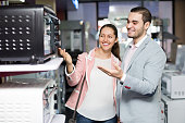 Couple choosing microwave oven