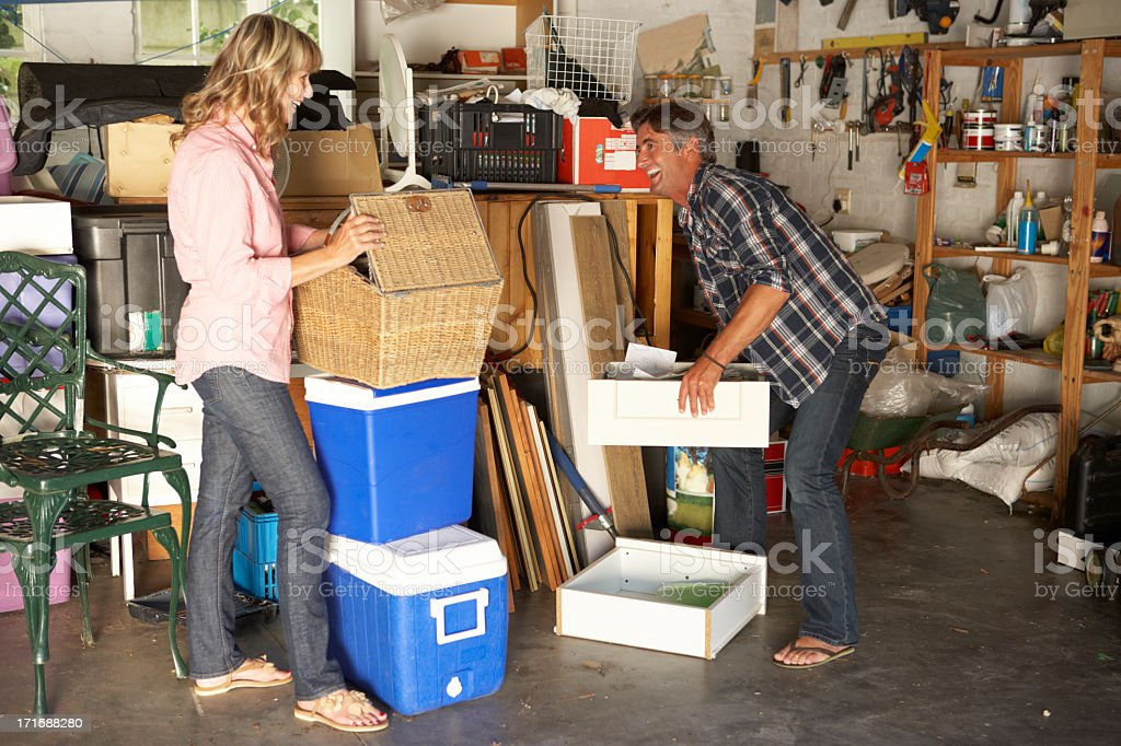 Couple Clearing Garage For Yard Sale royalty-free stock photo