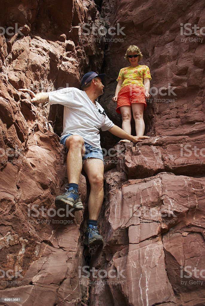 Couple climbing in red rocks royalty-free stock photo