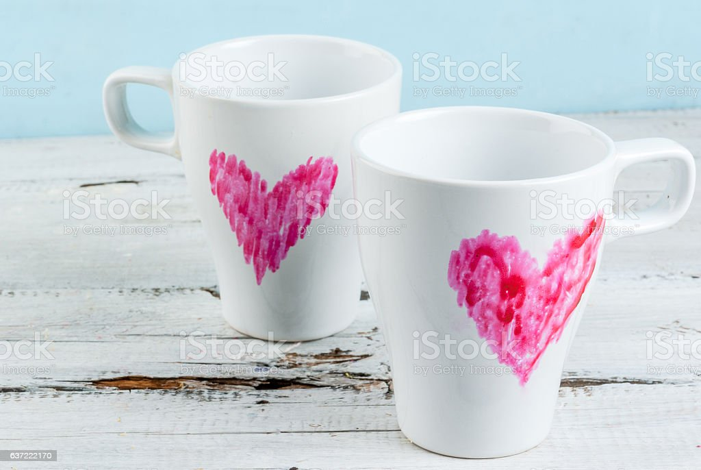 Couple coffee mugs with hearts painted with lipstick stock photo