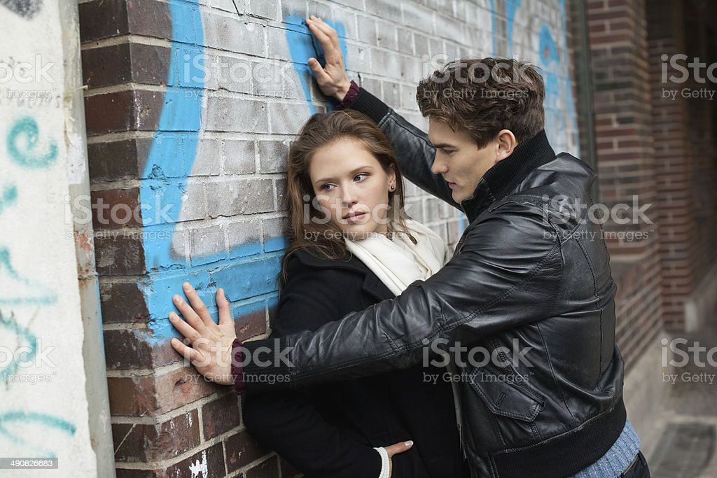 Couple conflict on street Leaning On Wall stock photo
