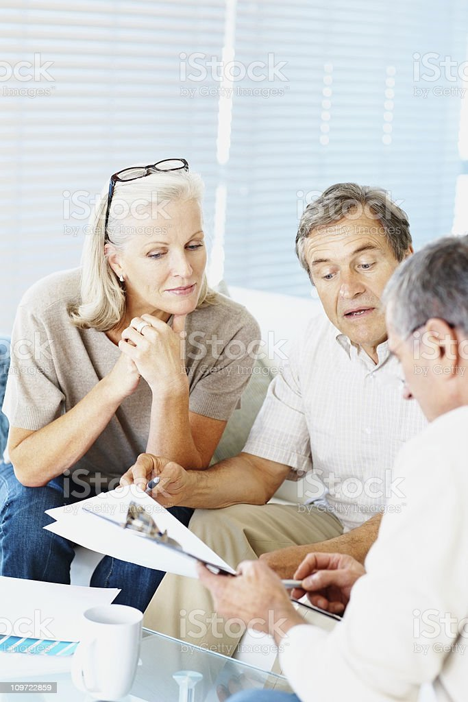 Couple consulting an interior designer for their new house royalty-free stock photo