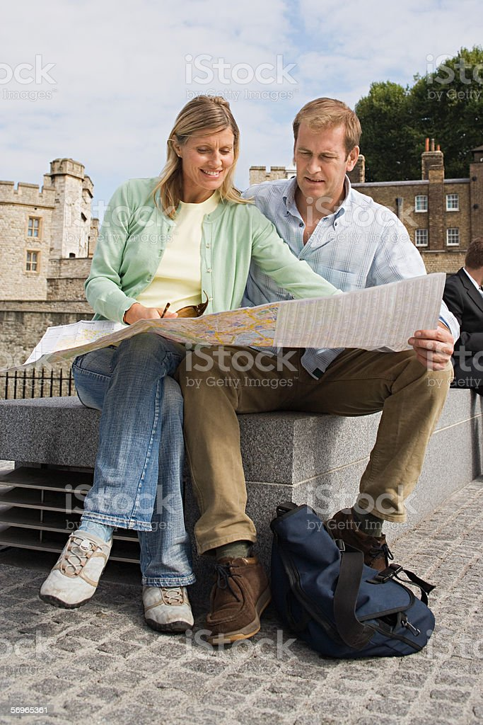 Couple consulting map royalty-free stock photo