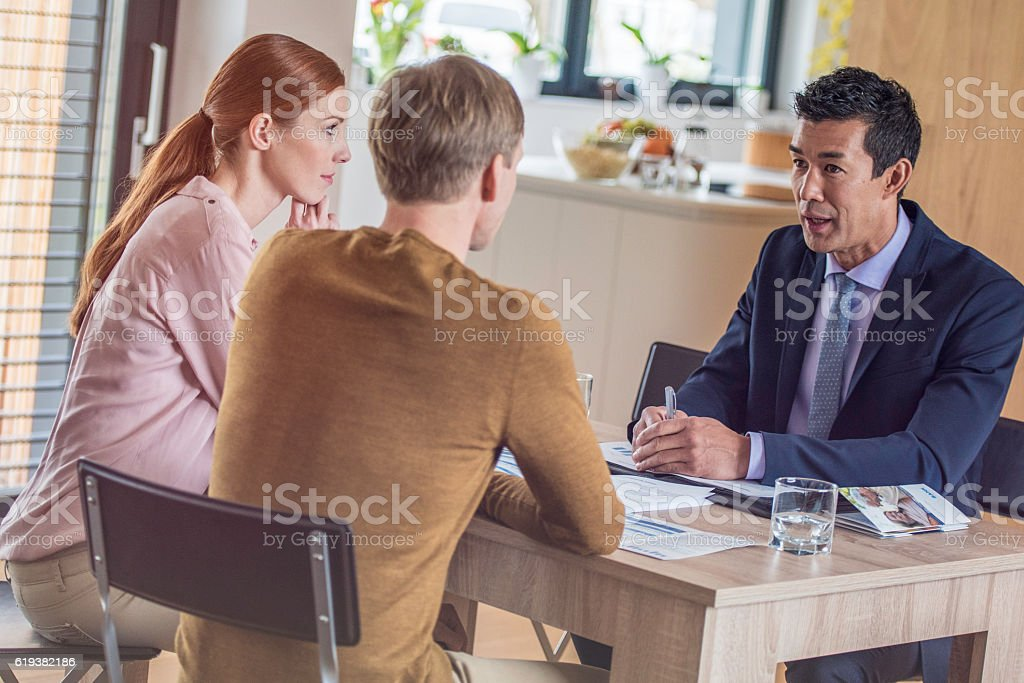 Couple consulting their insurance agent stock photo