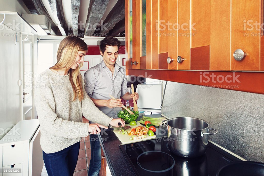 Couple Cooking a Meal stock photo