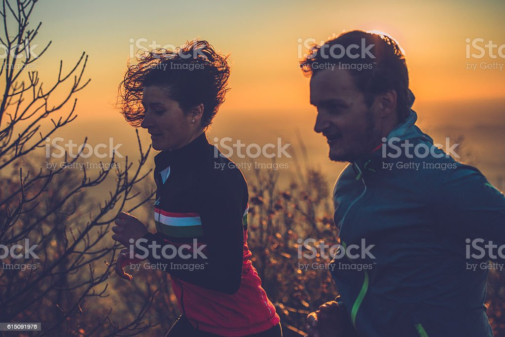 Couple Cross-Country Mountain Running in Julian Alps, Autumn, Europe stock photo