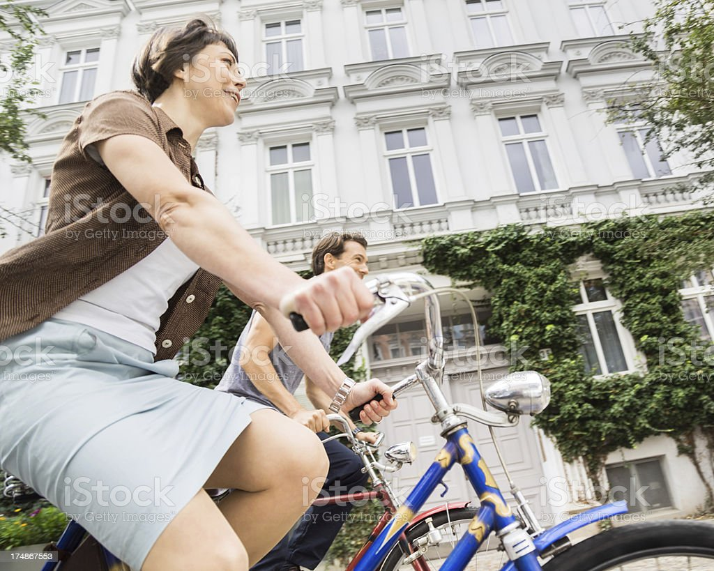 Couple Cycling in Berlin, Germany stock photo
