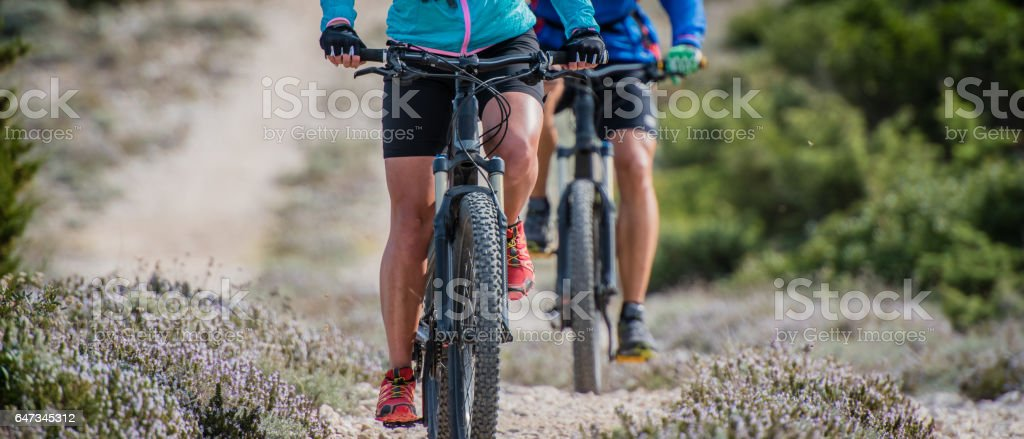 Couple cycling on bicycle trail stock photo