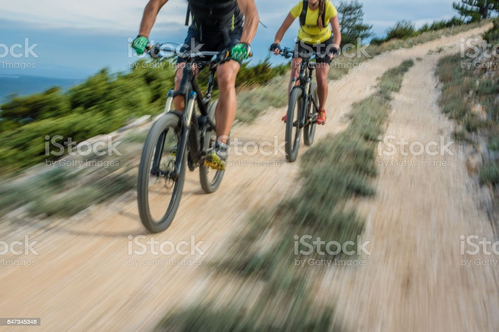 Couple cycling stock photo