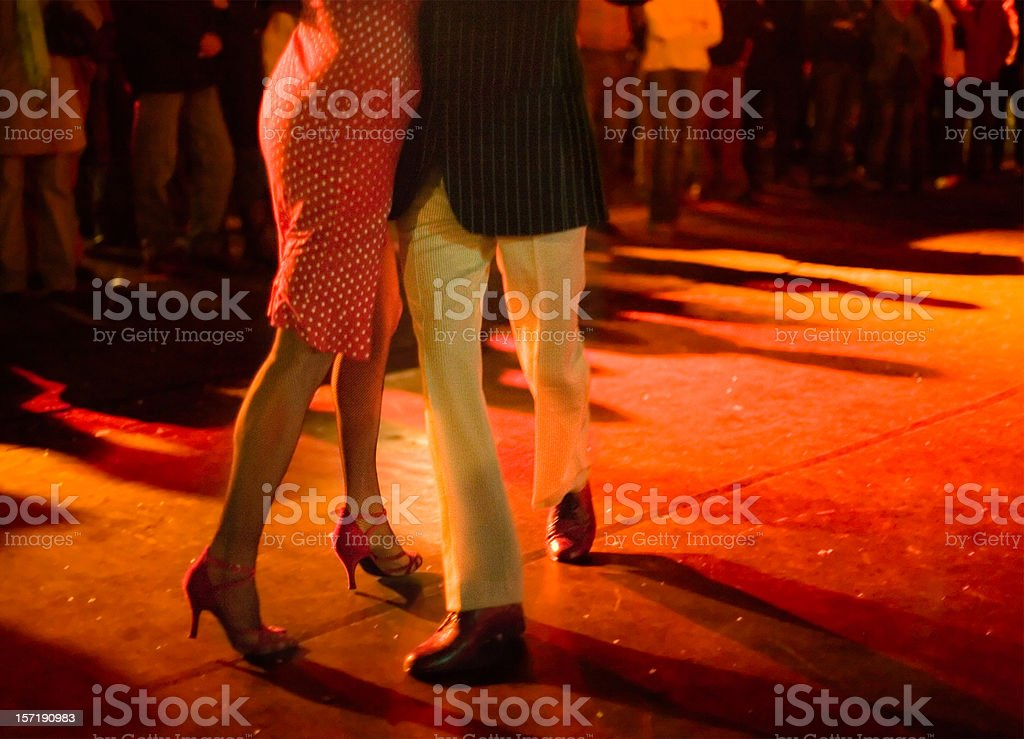Couple dancing Argentine Tango outdoors at night. royalty-free stock photo